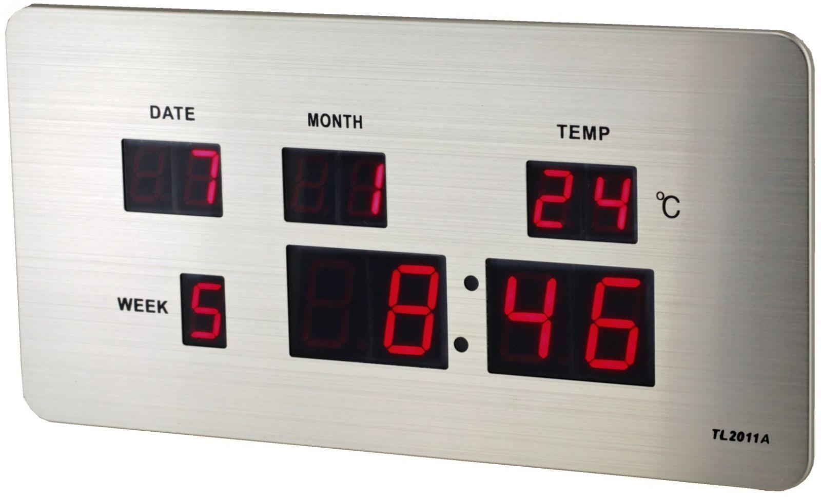 Digitální budík s červenými LED diodami, datem a teploměrem k postavení na stůl nebo pověšení na zeď.068 167377