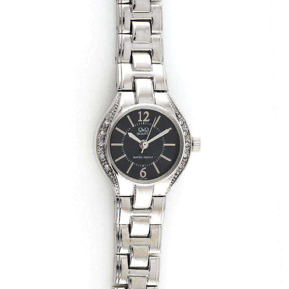 Dámské společenské hodinky s černým číselníkem po obvodu zdobené kamínky..0465 170810 Hodiny