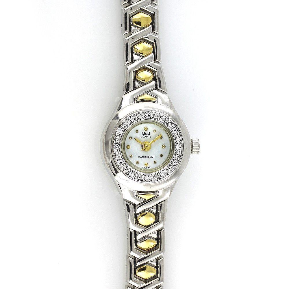Dámské zdobené hodinky se zlatým číselníkem na kovovém řemínku stříbrno-zlaté barvy..0472 170817 Hodiny