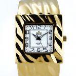 Pevné náramkové hodinky na klip. Celkově působí jako náramek..0392 170761 Hodiny