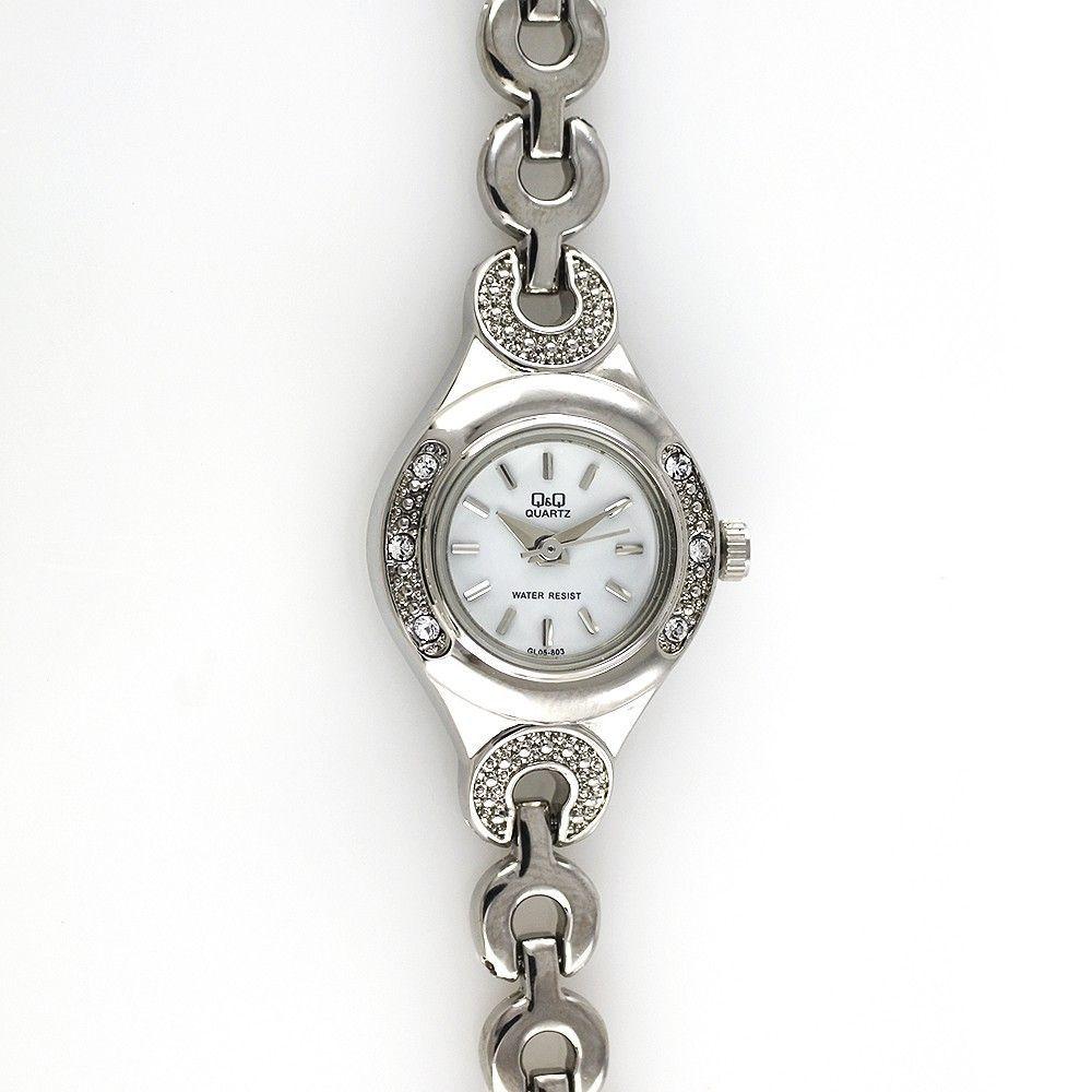 Společenské hodinky zdobené kamínky s bílým quartz číselníkem..0467 170812 Hodiny